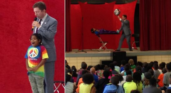 Atlanta magician Joe M. Turner performs a magical levitation with a volunteer on June 3, 2015.
