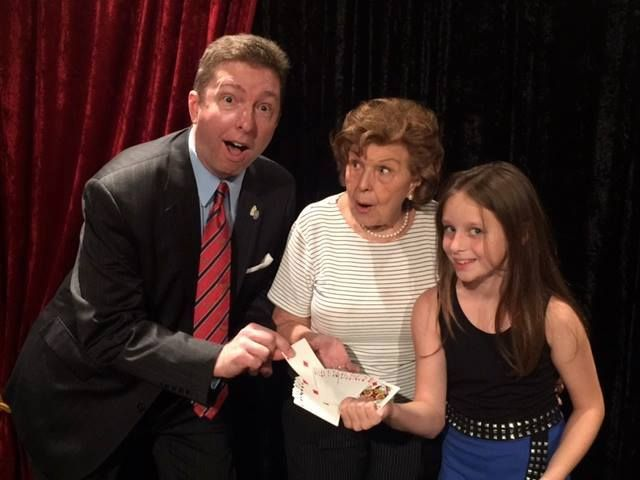 Atlanta magician Joe M. Turner, Mary Naylor-Kodell, and Lydia Coomes having fun after the show.